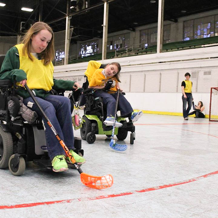 Feirer (left) and Katie Frayer (right), a freshman in MSU's Mechanical Engineering program, play power hockey on Fridays at the Demonstration Hall. Photo by Miguel Martinez-Valle.