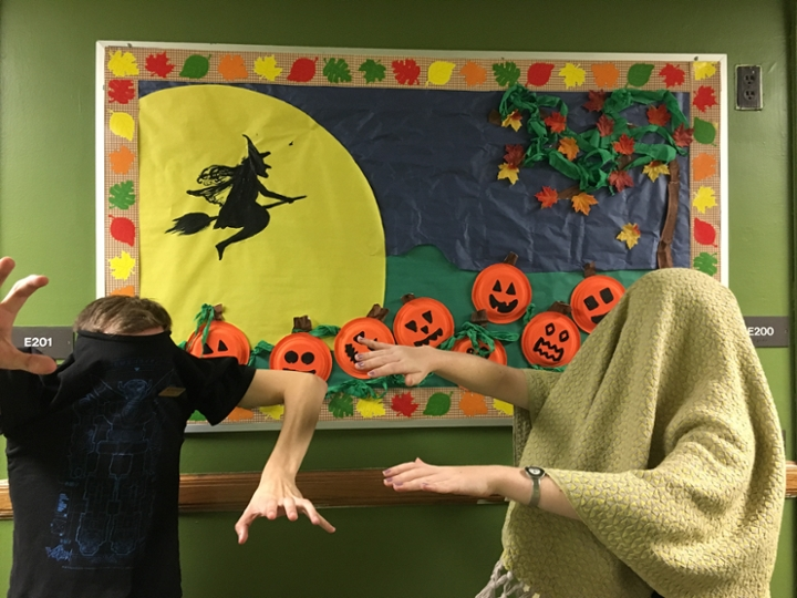 SnyPhi RAs Kelci Henson-Forslund and Trever Daniels in front of a Halloween Bulletin Board