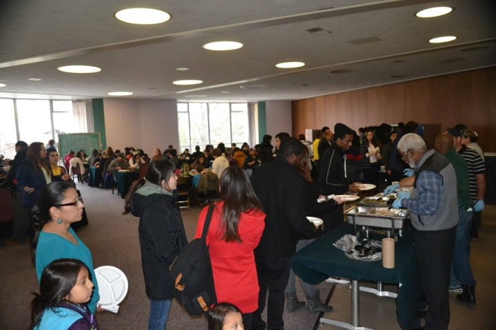 Members of the Spartan community explore the food selection at the 2014 Thanksgiving Fellowship Dinner.