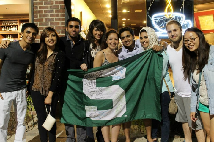 Alamiri (third from right) poses with her husband (fourth from right) and Spartan friends from across the globe.