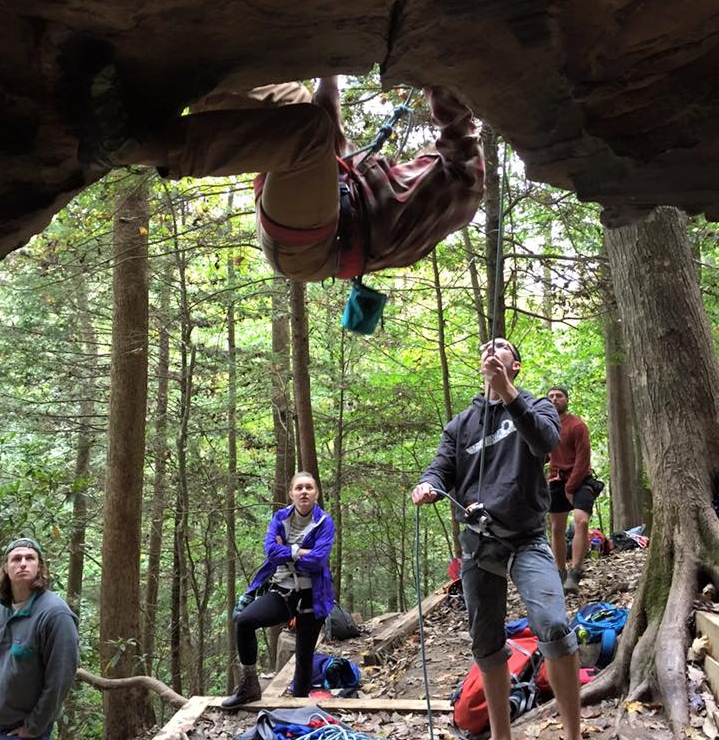Members of the MSU Climbing Club watch as senior Nick Empey starts a climb at the Red River Gorge in Kentucky.