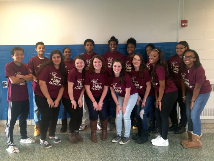 Justice (center) poses with the College Ambassadors Club that she sponsors at Waverly High School.