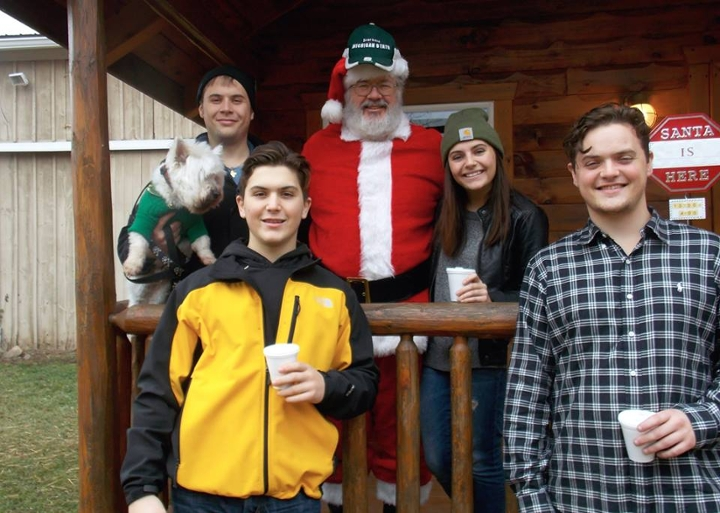 Here, my three bothers and I pose with Santa Claus at Mutch's Hidden Pines in Lapeer, Mich. Santa is sporting a Michigan State hat. Go green!