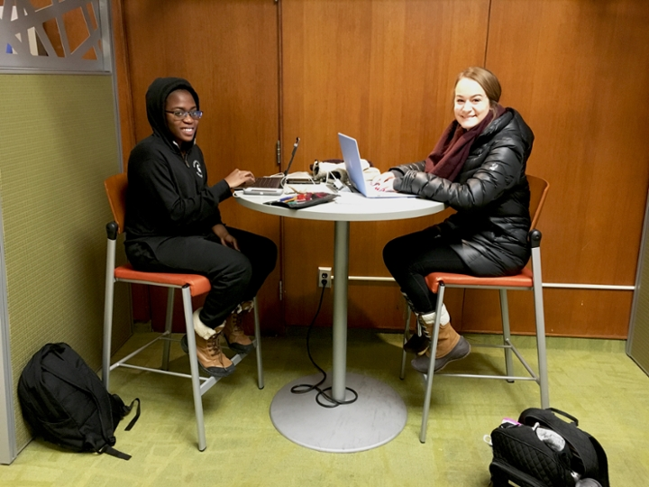 Sophomores Sylvia Danso Adjei of Accra, Uganda and Lydia Hilary of Rockford, Michigan study in the Student Services building for their classes as human biology majors.