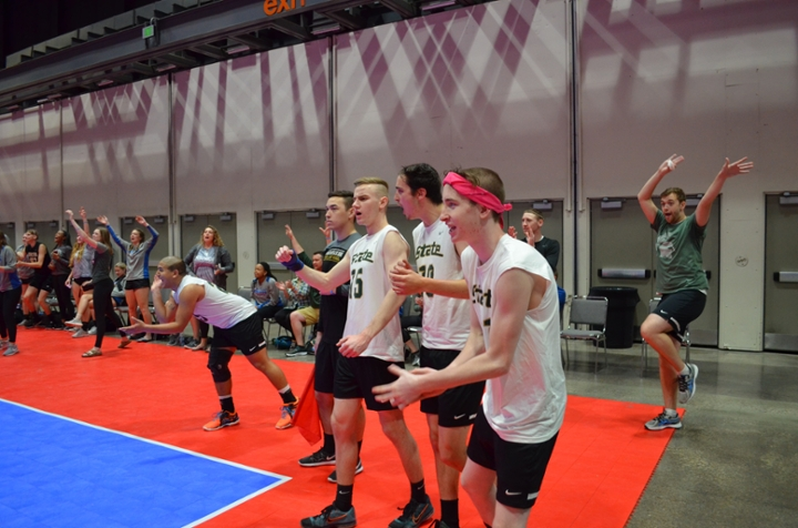 MSU Men's Volleyball Club and fans cheer on the team