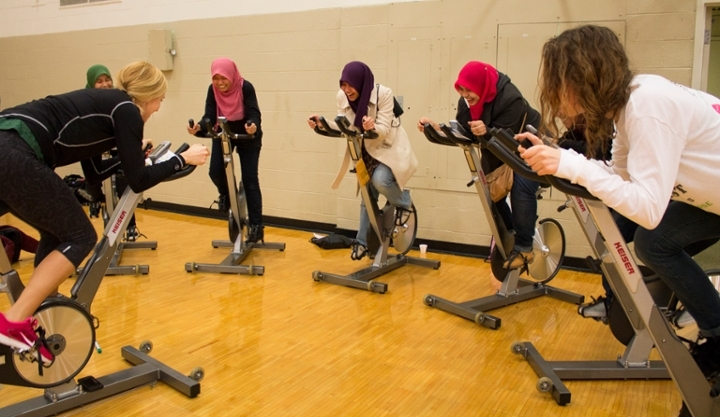 Students participate in a cycling demonstration at the 2014 Rec Fest event.